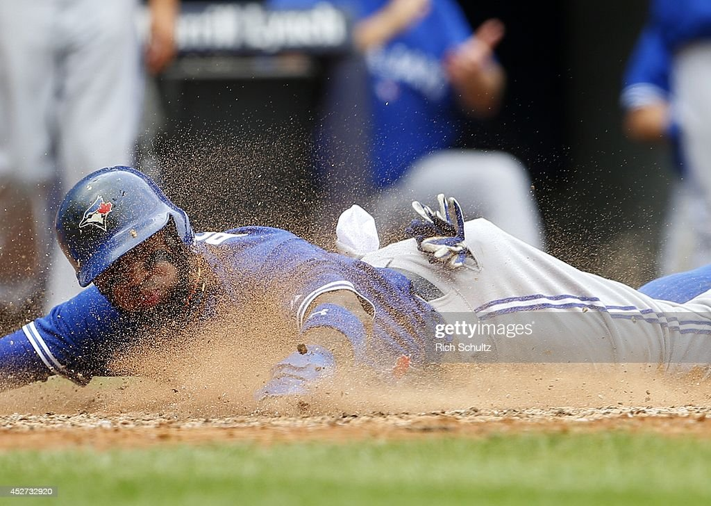 Jose Reyes #7 of the Toronto Blue Jays scores on a double by Melky Cabrera #53 against the New York Yankees in the fifth inning during a MLB baseball game at Yankee Stadium on July 26, 2014 in the Bronx borough of New York City.