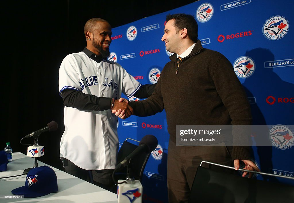 Jose Reyes #7 of the Toronto Blue Jays shakes hands with general manager Alex Anthopoulos at the conclusion of his press conference at Rogers Centre on January 17, 2013 in Toronto, Ontario.