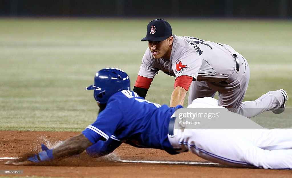 Jose Reyes #7 of the Toronto Blue Jays slides into third against Will Middlebrooks #16 of the Boston Red Sox in the first inning during MLB action at the Rogers Centre April 5, 2013 in Toronto, Ontario, Canada.