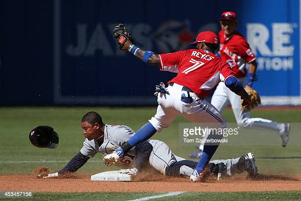 Jose Reyes of the Toronto Blue Jays tags out Ezequiel Carrera of the Detroit Tigers to catch him stealing in the eighth inning during MLB game action...