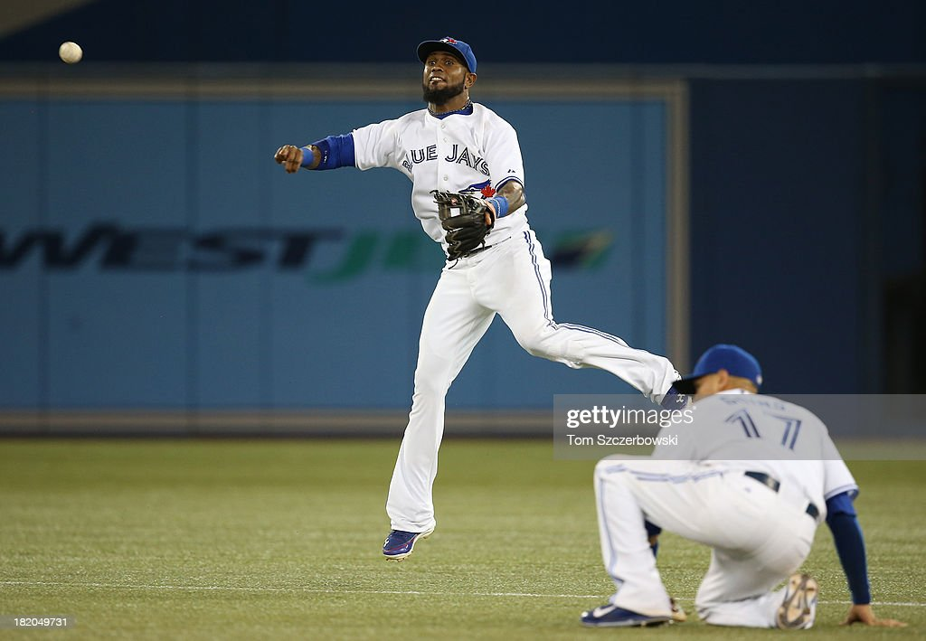 Jose Reyes #7 of the Toronto Blue Jays throws out a baserunner in the sixth inning during MLB game action against the Tampa Bay Rays on September 27, 2013 at Rogers Centre in Toronto, Ontario, Canada.