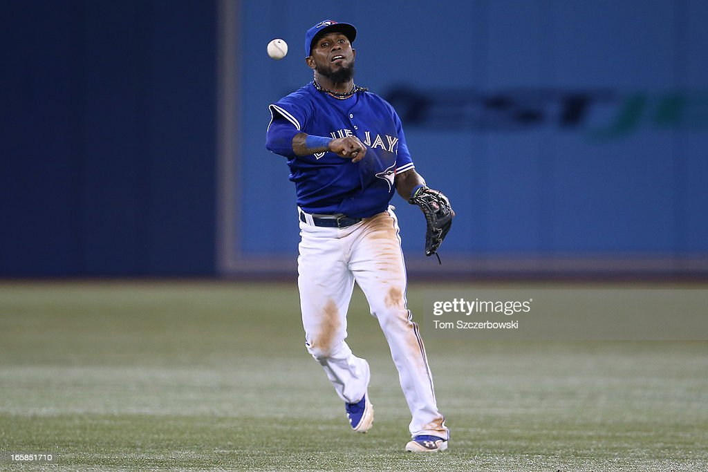 Jose Reyes #7 of the Toronto Blue Jays throws out the baserunner in the seventh inning during MLB game action against the Boston Red Sox on April 6, 2013 at Rogers Centre in Toronto, Ontario, Canada.
