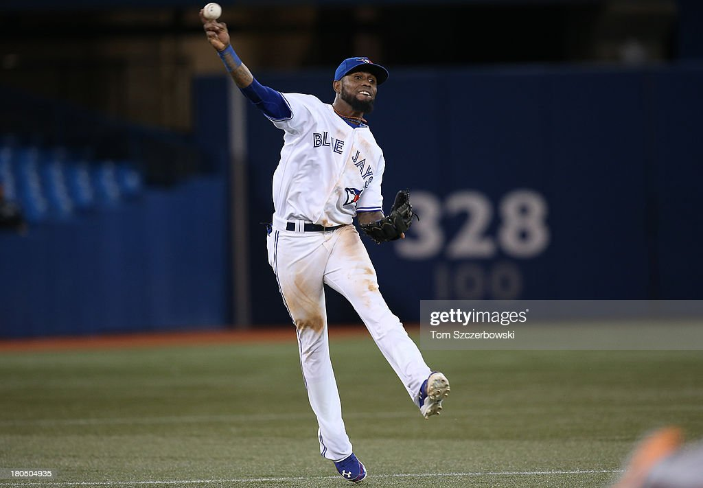 Jose Reyes #7 of the Toronto Blue Jays throws out the baserunner in the ninth inning during MLB game action against the Baltimore Orioles on September 13, 2013 at Rogers Centre in Toronto, Ontario, Canada.