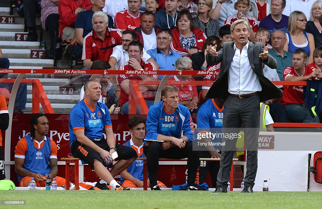 Jose Riga, Manager of Blackpool gives a message to his players during the Sky Bet Championship match between Nottingham Forest and Blackpool at City Ground on August 9, 2014 in Nottingham, England.