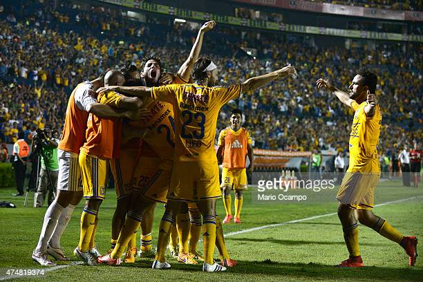 Jose Rivas of Tigres celebrates with teammates after scoring his team's second goal during a quarterfinal second leg match between Tigres and Emelec...