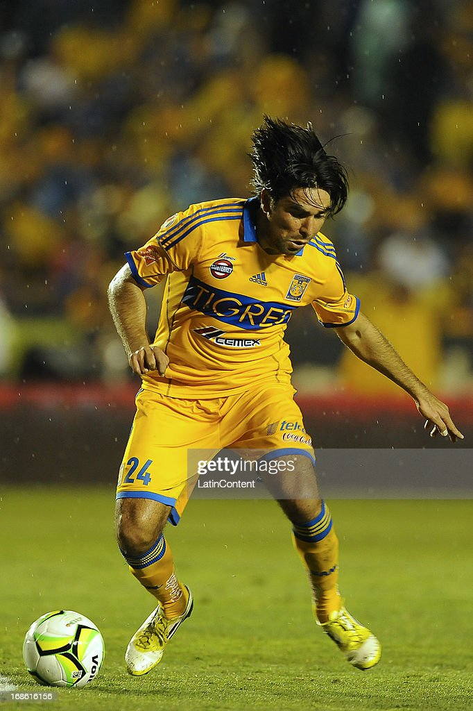 Jose Rivas of Tigres drives the ball during the match between Tigres and Monterrey as part of the Clausura Tournament 2013 on May 11, 2013 in Monterrey, Mexico.