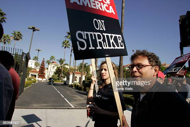 Jose Rivera walks the picket line in front of Paramount Studios with fellow writer Nicole Scipione