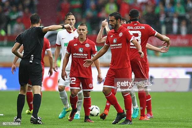 Jose Rodriguez of Mainz receives the red card from referee Bastian Dankert during the Bundesliga match between FC Augsburg and 1 FSV Mainz 05 at WWK...