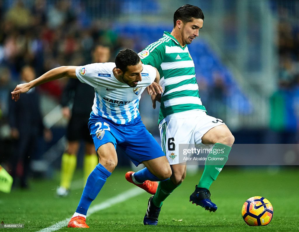 Jose Rodriguez of Malaga CF (L) competes for the ball with Felipe Gutierrez of Real Betis Balompie (R) during La Liga match between Malaga CF and Real Betis Balompie at La Rosaleda Stadium February 28, 2017 in Malaga, Spain.