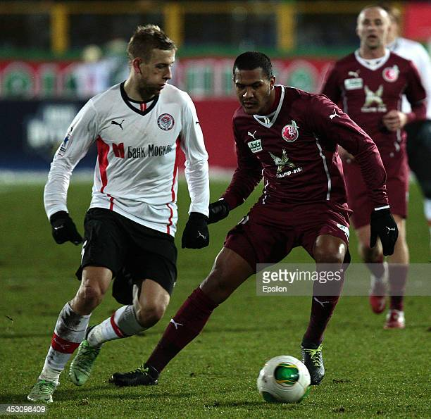 Jose Rondon of FC Rubin Kazan is challenged by Janusz Gol of FC Amkar Perm during the Russian Football League Championship match between FC Rubin...