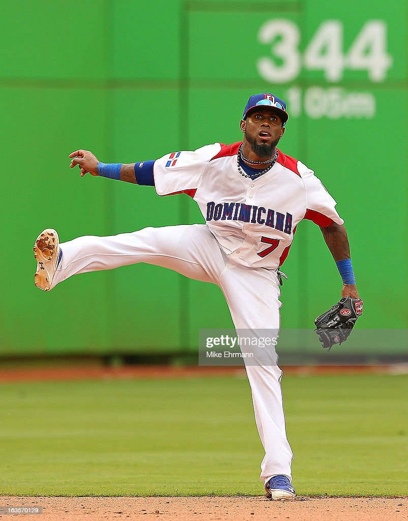 Jose Ryes #7 of the Dominican Republic makes a throw to first during a World Baseball Classic second round game against Italy at Marlins Park on March 12, 2013 in Miami, Florida.