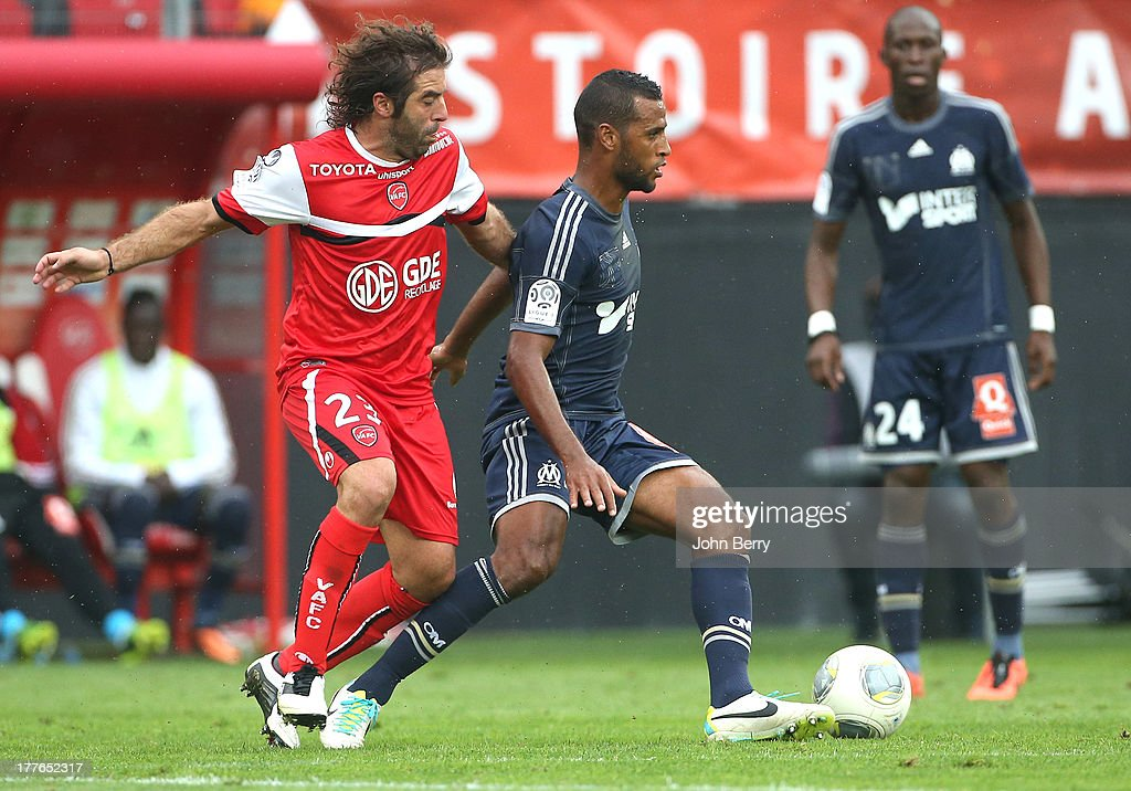 <a gi-track='captionPersonalityLinkClicked' href=/galleries/search?phrase=Jose+Saez&family=editorial&specificpeople=2527776 ng-click='$event.stopPropagation()'>Jose Saez</a> of Valenciennes and Jacques-Alaixys Romao of OM in action during the French Ligue 1 match between Valenciennes FC and Olympique de Marseille OM at the Stade du Hainaut stadium on August 24, 2013 in Valenciennes, France.