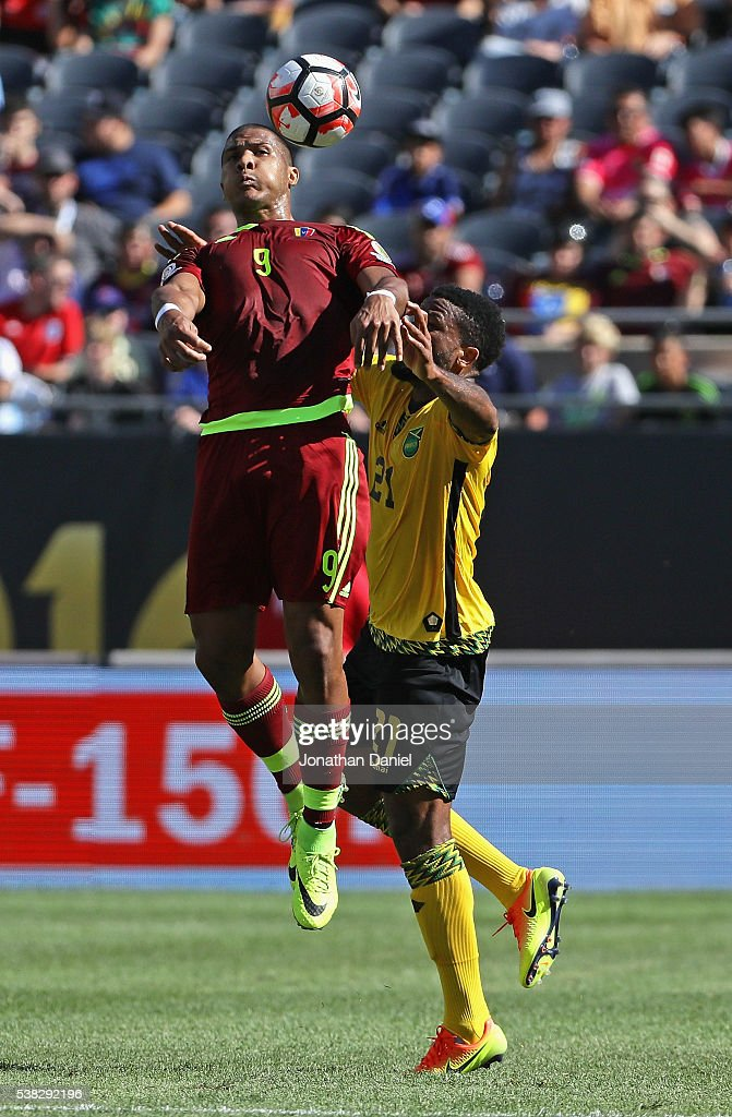 <a gi-track='captionPersonalityLinkClicked' href=/galleries/search?phrase=Jose+Salomon+Rondon&family=editorial&specificpeople=6355029 ng-click='$event.stopPropagation()'>Jose Salomon Rondon</a> #9 of Venezuela heads the ball over <a gi-track='captionPersonalityLinkClicked' href=/galleries/search?phrase=Jermaine+Taylor+-+Soccer+Player&family=editorial&specificpeople=13524207 ng-click='$event.stopPropagation()'>Jermaine Taylor</a> #21 of Jamaica during a match in the 2016 Copa America Centenario at Soldier Field on June 5, 2016 in Chicago, Illinois.