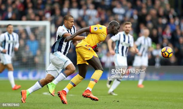 Jose Salomon Rondon of West Bromwich Albion and Mamadou Sakho of Crystal Palace battle for possession during the Premier League match between West...