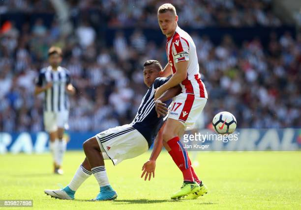 Jose Salomon Rondon of West Bromwich Albion and Ryan Shawcross of Stoke City battle for possession during the Premier League match between West...