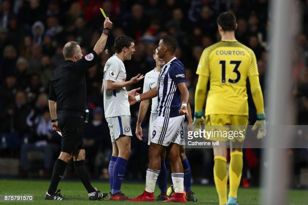 Jose Salomon Rondon of West Bromwich Albion is shown a yellow card by referee Jonathan Moss during the Premier League match between West Bromwich...