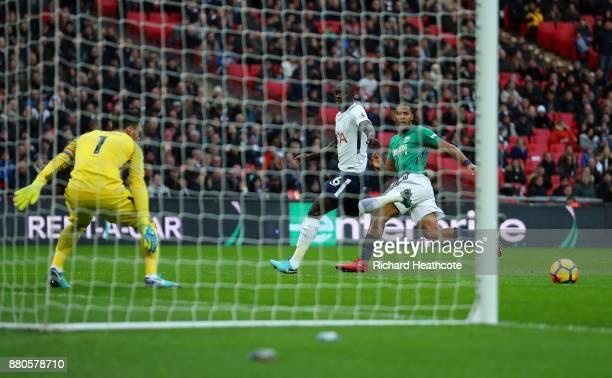 Jose Salomon Rondon of West Bromwich Albion scores his sides first goal as Davinson Sanchez of Tottenham Hotspur attempts to block during the Premier...