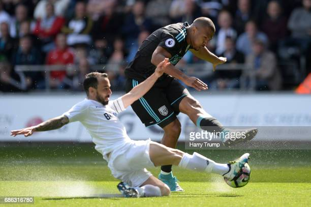 Jose Salomon Rondon of West Bromwich Albion shoots as Leon Britton of Swansea City attempts to block during the Premier League match between Swansea...