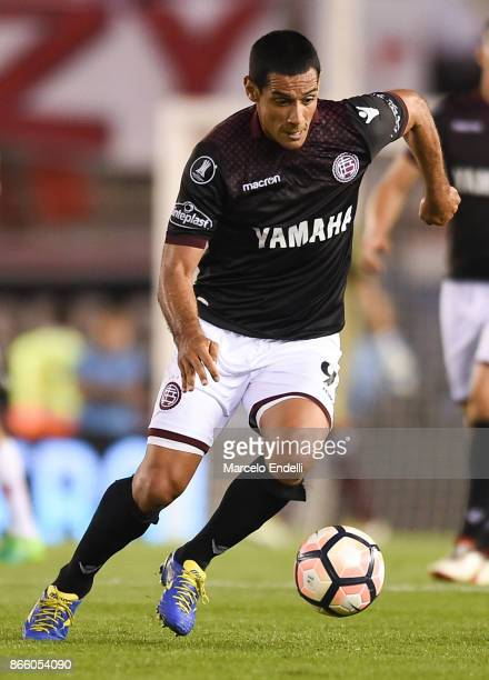 Jose Sand of Lanus drives the ball during a first leg match between River Plate and Lanus as part of semifinals of Copa CONMEBOL Libertadores...