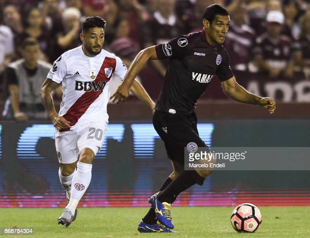 Jose Sand of Lanus drives the ball under pressure of Milton Casco of River Plate during a second leg match between Lanus and River Plate as part of...