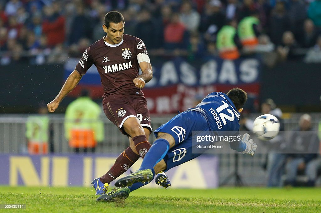 Jose Sand of Lanus shoots to score the third goal of his team during a final match between San Lorenzo and Lanus as part of Torneo Transicion 2016 at Monumental Stadium on May 29, 2016 in Buenos Aires, Argentina.