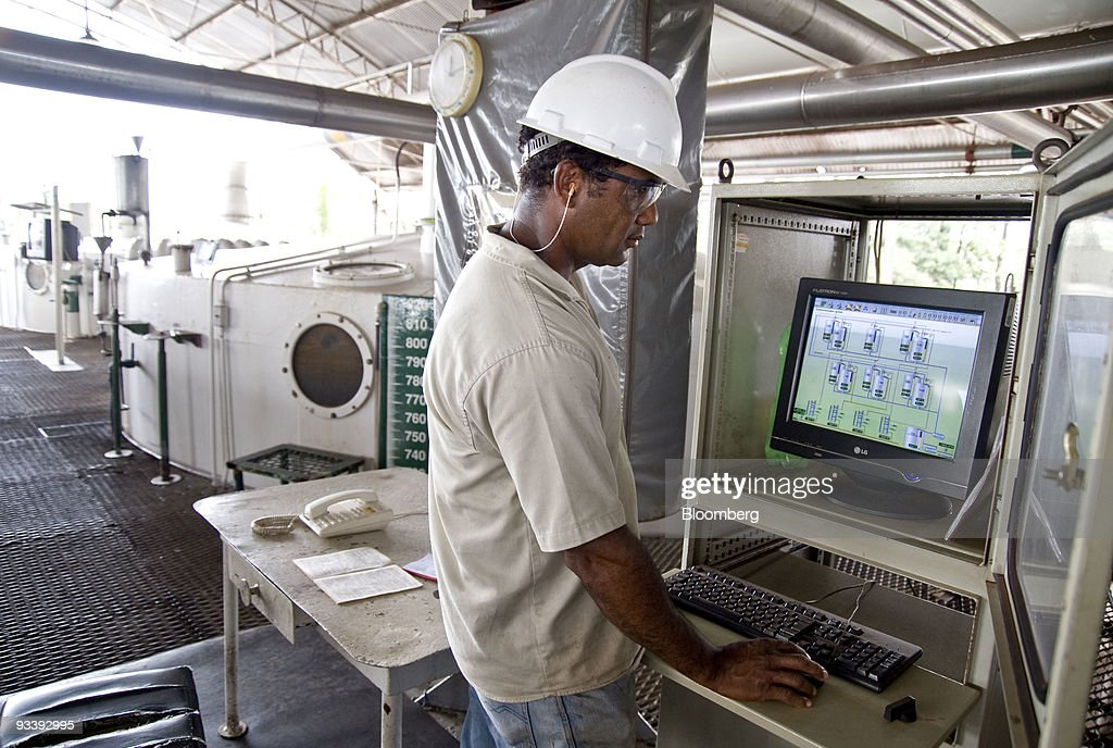 <a gi-track='captionPersonalityLinkClicked' href=/galleries/search?phrase=Jose+Santos&family=editorial&specificpeople=233439 ng-click='$event.stopPropagation()'>Jose Santos</a> watches a panel that shows the fermentation of the ethanol at the Pedra Agroindustrial S/A Usina de Pedra plant near Ribeirao Preto, Brazil, on Tuesday, Nov. 24, 2009. Brazil may import ethanol from the U.S. after rains disrupted this year's harvest of sugar cane, used to make the product. Photographer: Paulo Fridman/Bloomberg via Getty Images