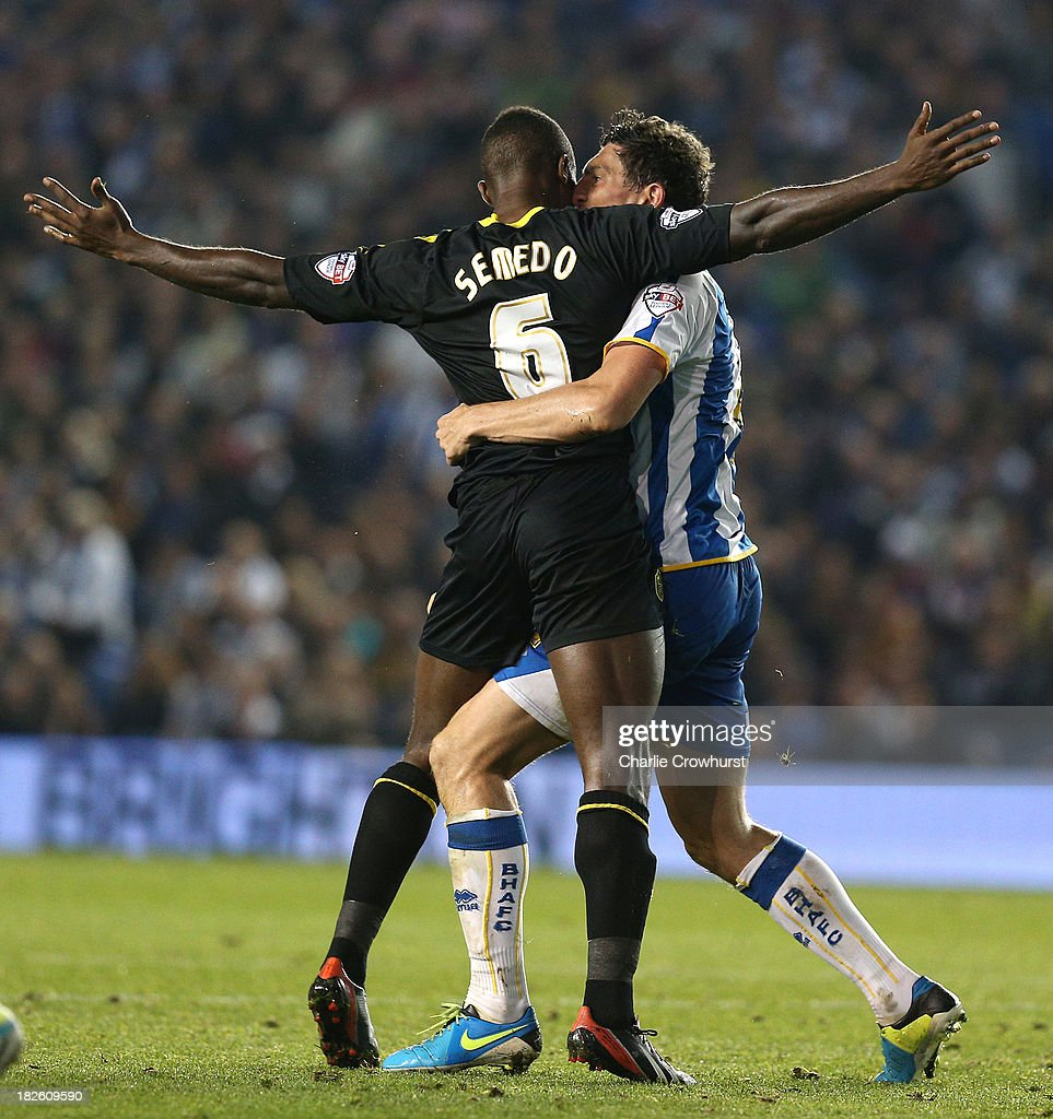 Jose Semedo of Sheffield Wednesday squares up to <a gi-track='captionPersonalityLinkClicked' href=/galleries/search?phrase=Keith+Andrews&family=editorial&specificpeople=661603 ng-click='$event.stopPropagation()'>Keith Andrews</a> of Brighton during the Sky Bet Championship match between Brighton & Hove Albion and Sheffield Wednesday at The Amex Stadium on October 01, 2013 in Brighton, England.