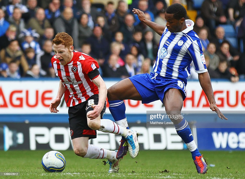 Jose Semedo of Sheffield Wednesday tackles Stephen Quinn of Sheffield United during the npower League One match between Sheffield Wednesday and Sheffield United at Hillsborough Stadium on February 26, 2012 in Sheffield, England.