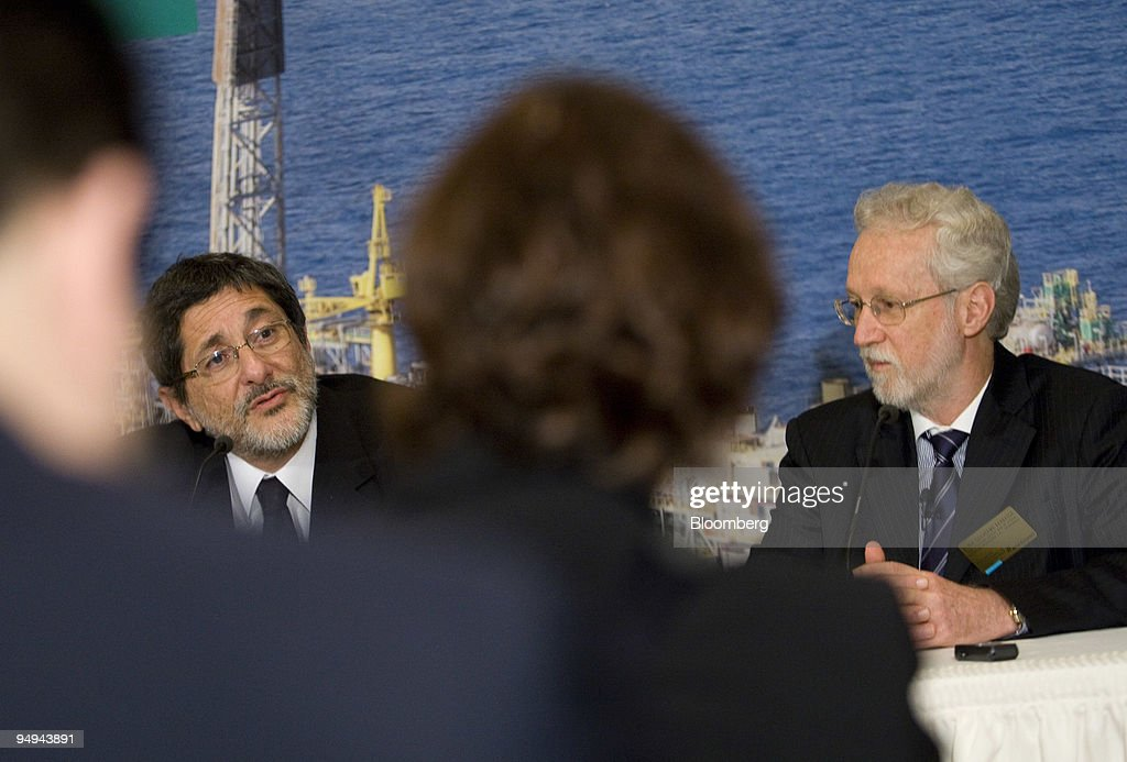 Jose Sergio Gabrielli, chief executive officer of Petroleo Brasileiro SA (Petrobras), left, speaks during a news conference with Almir Guilherme Barbassa, chief financial officer of Petrobras, at the New York Stock Exchange in New York, U.S., on Thursday, May 21, 2009. China Petroleum, also known as Sinopec, will get 150,000 barrels of oil a day this year from Petrobras under one of 13 accords signed this week in Beijing and 200,000 barrels a day between 2010 and 2019.
