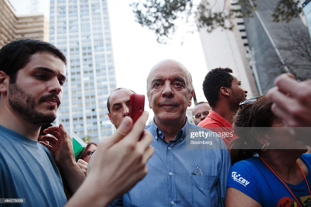 Jose Serra, former governor of Sao Paulo, center, marches with other demonstrators during a protest in Sao Paulo, Brazil, on Sunday, Aug. 16, 2015. Nationwide street protests Sunday against Brazilian President Dilma Rousseff kept the pressure on the government without dealing her administration a fatal blow. Photographer: Patricia Monteiro/Bloomberg via Getty Images