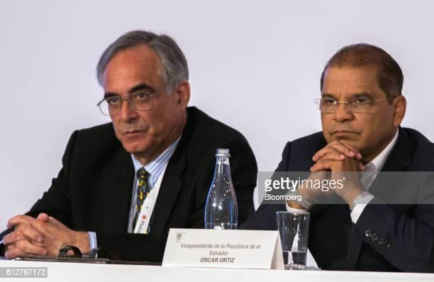 Jose Sette executive director of the International Coffee Organization left and Oscar Ortiz El Salvador's vice president listen during the World...