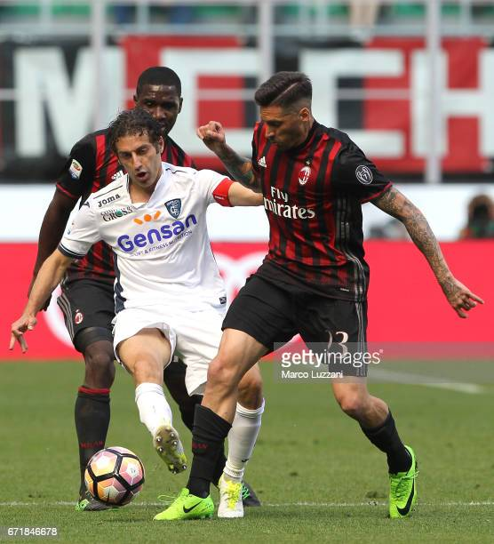 Jose Sosa of AC Milan competes for the ball with Daniele Croce of Empoli FC during the Serie A match between AC Milan and Empoli FC at Stadio...