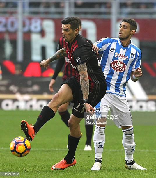 Jose Sosa of AC Milan competes for the ball with Gaston Brugman of Pescara Calcio during the Serie A match between AC Milan and Pescara Calcio at...