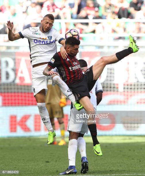 Jose Sosa of AC Milan competes for the ball with Omar El Kaddouri of Empoli FC during the Serie A match between AC Milan and Empoli FC at Stadio...