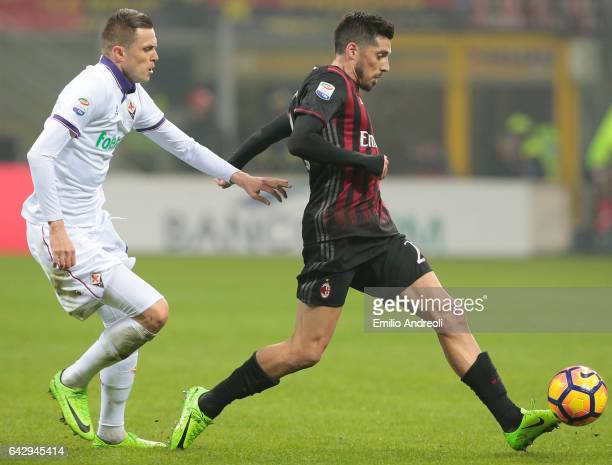 Jose Sosa of AC Milan is challenged by Josip Ilicic of ACF Fiorentina during the Serie A match between AC Milan and ACF Fiorentina at Stadio Giuseppe...
