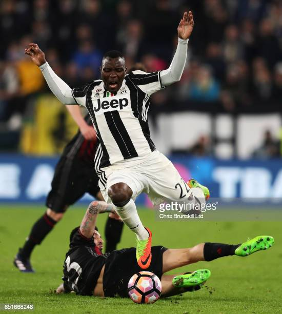 Jose Sosa of AC Milan tackles Kwadwo Asamoah of Juventus and is subsequently shown a red card during the Serie A match between Juventus FC and AC...