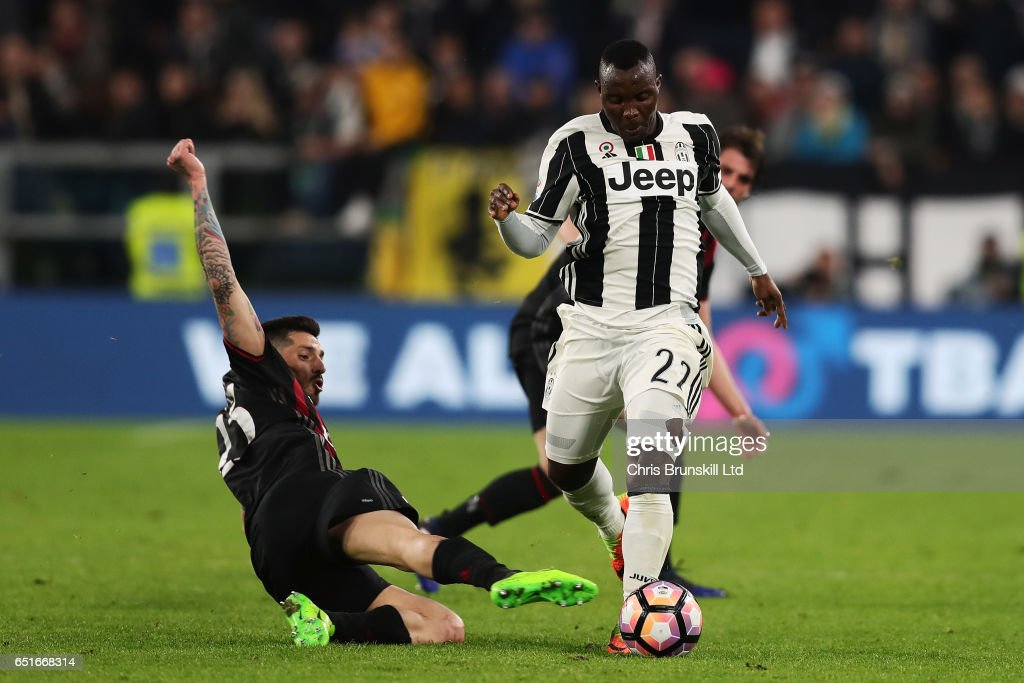Jose Sosa of AC Milan tackles Kwadwo Asamoah of Juventus and is subsequently shown a red card during the Serie A match between Juventus FC and AC Milan at Juventus Stadium on March 10, 2017 in Turin, Italy.