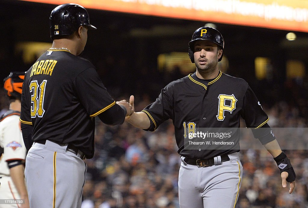 <a gi-track='captionPersonalityLinkClicked' href=/galleries/search?phrase=Jose+Tabata&family=editorial&specificpeople=759093 ng-click='$event.stopPropagation()'>Jose Tabata</a> #31 and Neil Walker #18 of the Pittsburgh Pirates celebrate after scoring on a Pedro Alvarez bases-loaded two-run double in the fifth inning against the San Francisco Giants at AT&T Park on August 22, 2013 in San Francisco, California.