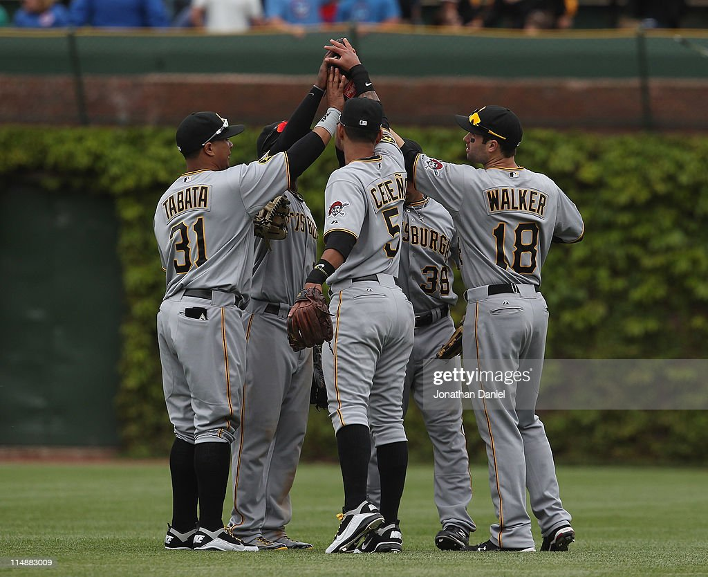 Jose Tabata Andrew McCutchen Ronny Cedeno Xavier Paul and Neil Walker of the Pittsburgh Pirates celebrate a win over the Chicago Cubs at Wrigley...