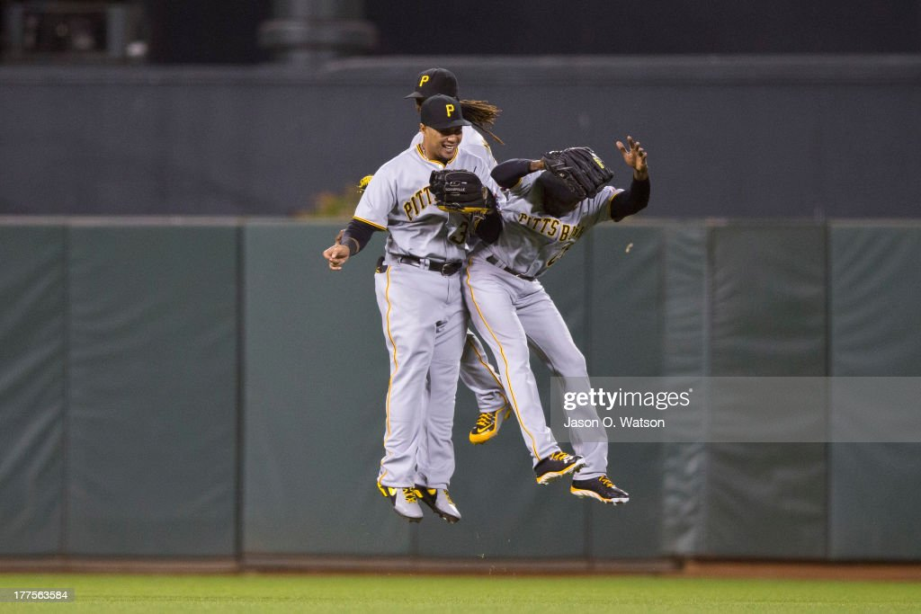 <a gi-track='captionPersonalityLinkClicked' href=/galleries/search?phrase=Jose+Tabata&family=editorial&specificpeople=759093 ng-click='$event.stopPropagation()'>Jose Tabata</a> #31 of the Pittsburgh Pirates, <a gi-track='captionPersonalityLinkClicked' href=/galleries/search?phrase=Andrew+McCutchen&family=editorial&specificpeople=2364814 ng-click='$event.stopPropagation()'>Andrew McCutchen</a> #22 and <a gi-track='captionPersonalityLinkClicked' href=/galleries/search?phrase=Felix+Pie&family=editorial&specificpeople=796554 ng-click='$event.stopPropagation()'>Felix Pie</a> #26 celebrate after the game against the San Francisco Giants at AT&T Park on August 23, 2013 in San Francisco, California. The Pittsburgh Pirates defeated the San Francisco Giants 3-1.