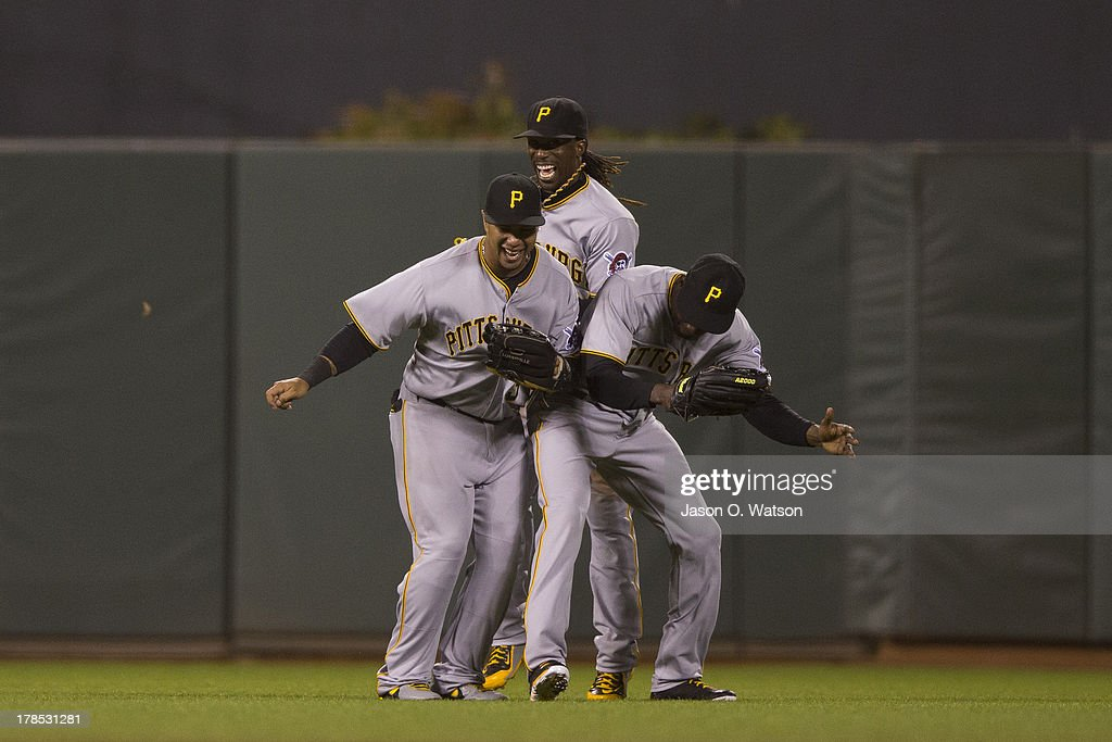 Jose Tabata #31 of the Pittsburgh Pirates, Andrew McCutchen #22 and Felix Pie #26 celebrate after the game against the San Francisco Giants at AT&T Park on August 23, 2013 in San Francisco, California. The Pittsburgh Pirates defeated the San Francisco Giants 3-1.