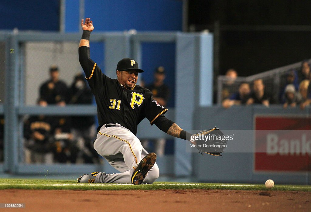 <a gi-track='captionPersonalityLinkClicked' href=/galleries/search?phrase=Jose+Tabata&family=editorial&specificpeople=759093 ng-click='$event.stopPropagation()'>Jose Tabata</a> #31 of the Pittsburgh Pirates can't make the catch on a foul ball hit by Mark Ellis #14 of the Los Angeles Dodgers (not in photo) in the fifth inning during the MLB game at Dodger Stadium on April 6, 2013 in Los Angeles, California.