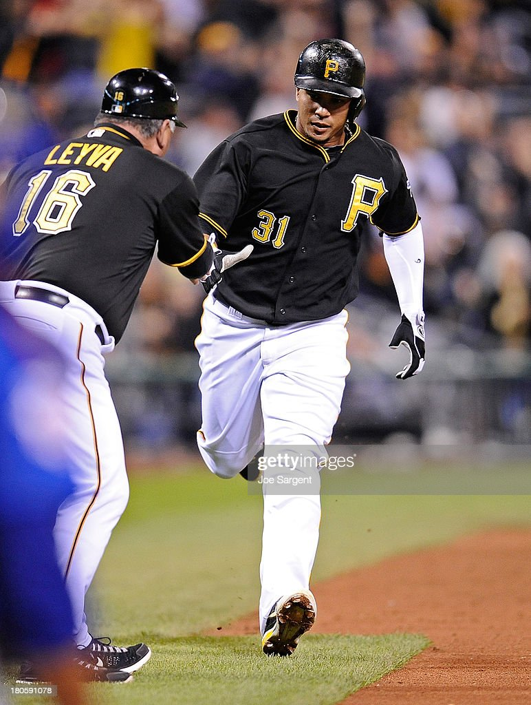 Jose Tabata #31 of the Pittsburgh Pirates celebrates with third base coach Nick Leyva after hitting a home run in the sixth inning against the Chicago Cubs on September 14, 2013 at PNC Park in Pittsburgh, Pennsylvania.