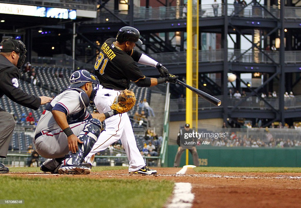 <a gi-track='captionPersonalityLinkClicked' href=/galleries/search?phrase=Jose+Tabata&family=editorial&specificpeople=759093 ng-click='$event.stopPropagation()'>Jose Tabata</a> #31 of the Pittsburgh Pirates hits a RBI double in the second inning against the Atlanta Braves during the game on April 19, 2013 at PNC Park in Pittsburgh, Pennsylvania.