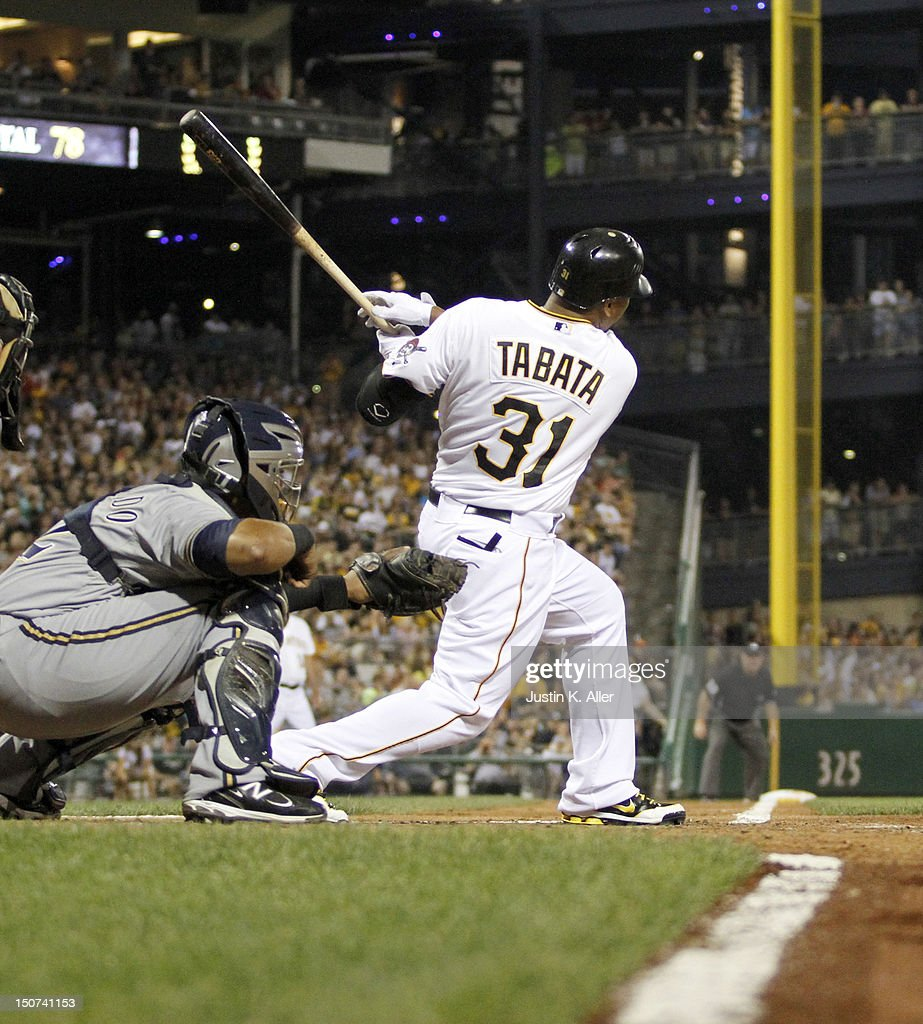 <a gi-track='captionPersonalityLinkClicked' href=/galleries/search?phrase=Jose+Tabata&family=editorial&specificpeople=759093 ng-click='$event.stopPropagation()'>Jose Tabata</a> #31 of the Pittsburgh Pirates hits an RBI double in the fifth inning against the Milwaukee Brewers during the game on August 25, 2012 at PNC Park in Pittsburgh, Pennsylvania.