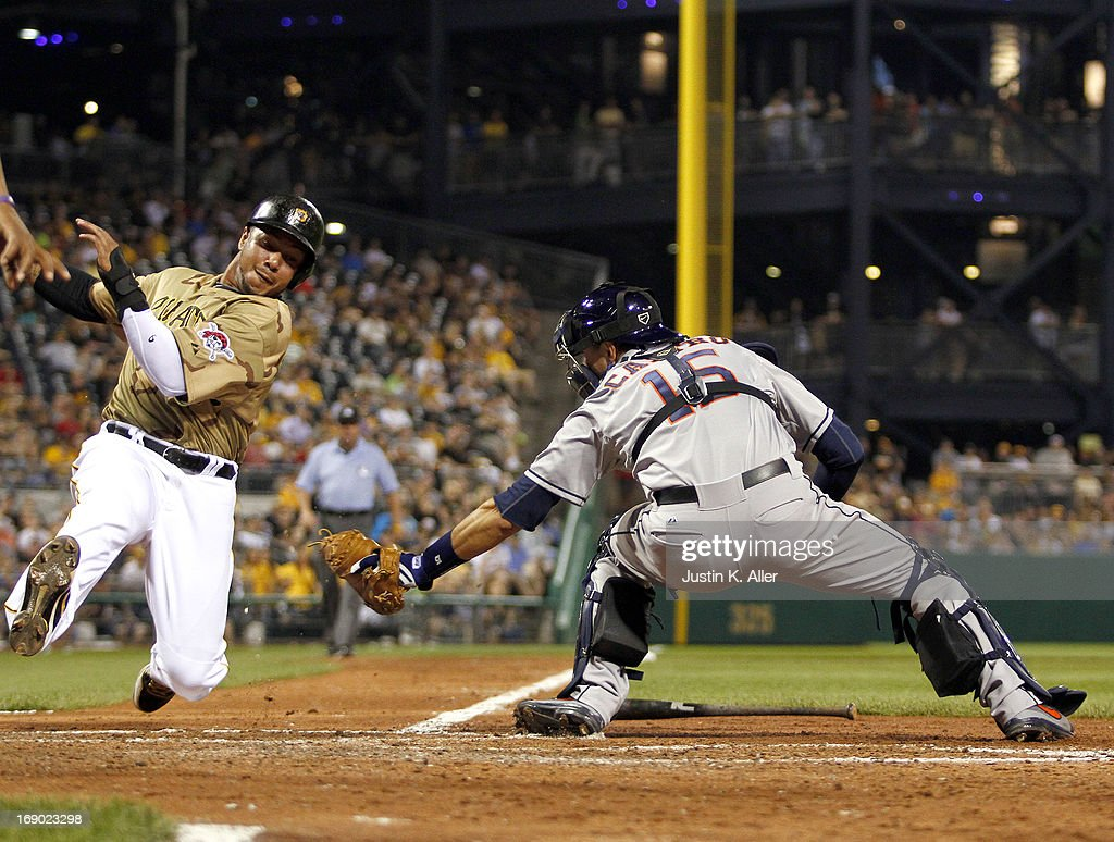 <a gi-track='captionPersonalityLinkClicked' href=/galleries/search?phrase=Jose+Tabata&family=editorial&specificpeople=759093 ng-click='$event.stopPropagation()'>Jose Tabata</a> #31 of the Pittsburgh Pirates is tagged out at home by Jason Castro #15 of the Houston Astros in the sixth inning during the game on May 18, 2013 at PNC Park in Pittsburgh, Pennsylvania.