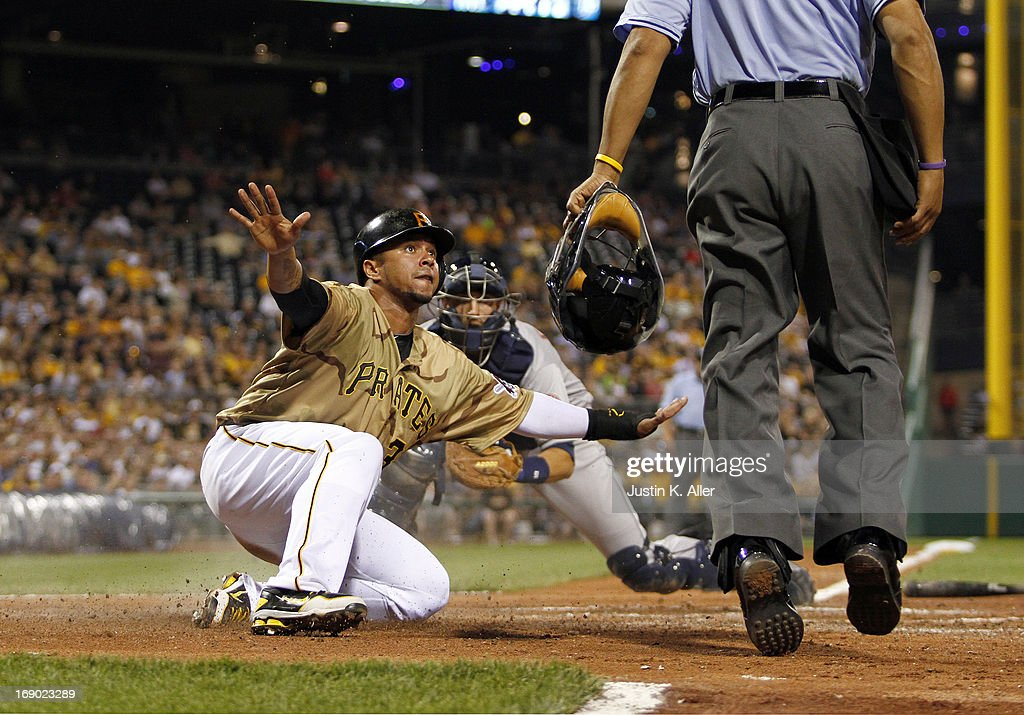 <a gi-track='captionPersonalityLinkClicked' href=/galleries/search?phrase=Jose+Tabata&family=editorial&specificpeople=759093 ng-click='$event.stopPropagation()'>Jose Tabata</a> #31 of the Pittsburgh Pirates reacts after being tagged out at home in the sixth inning by Jason Castro #15 of the Houston Astros during the game on May 18, 2013 at PNC Park in Pittsburgh, Pennsylvania.