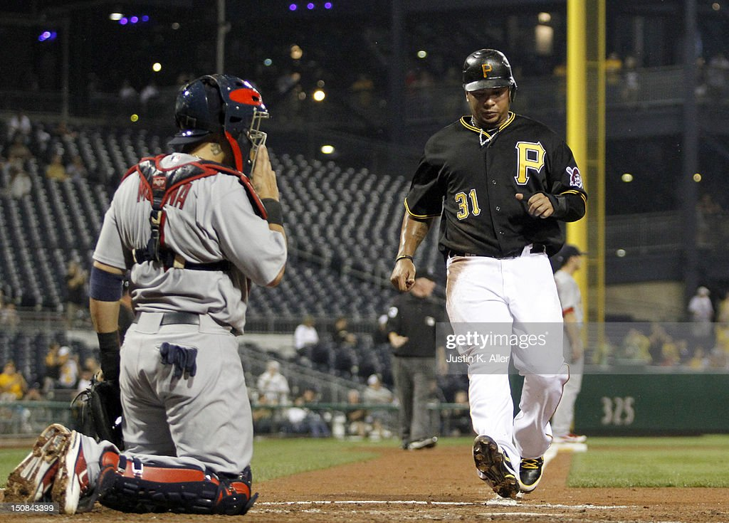 <a gi-track='captionPersonalityLinkClicked' href=/galleries/search?phrase=Jose+Tabata&family=editorial&specificpeople=759093 ng-click='$event.stopPropagation()'>Jose Tabata</a> #31 of the Pittsburgh Pirates scores on an RBI single in the fourth inning against the St. Louis Cardinals during the game on August 27, 2012 at PNC Park in Pittsburgh, Pennsylvania.