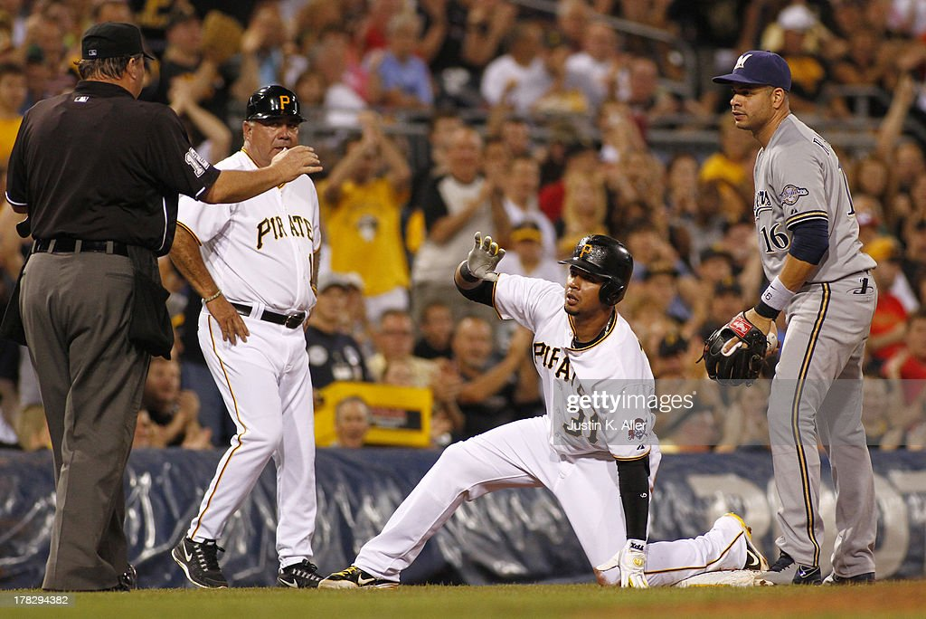<a gi-track='captionPersonalityLinkClicked' href=/galleries/search?phrase=Jose+Tabata&family=editorial&specificpeople=759093 ng-click='$event.stopPropagation()'>Jose Tabata</a> #31 of the Pittsburgh Pirates slides in safe at third against <a gi-track='captionPersonalityLinkClicked' href=/galleries/search?phrase=Aramis+Ramirez&family=editorial&specificpeople=239509 ng-click='$event.stopPropagation()'>Aramis Ramirez</a> #16 of the Milwaukee Brewers in the fifth inning during the game on August 28, 2013 at PNC Park in Pittsburgh, Pennsylvania.