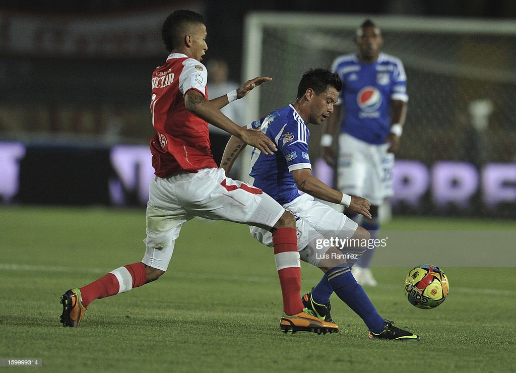 Jose Tancredi (R) of Millonarios fights for the ball with Francisco Meza (L) of Independiente Santa Fe during a match between Millonarios and Independiente Santa Fe as part of the Superliga Postobon 2013 at the Nemesio Camacho Stadium on January 24, 2013 in Bogota, Colombia.